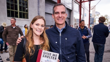 1._intern_annabelle_bardenheier_with_the_mayor_of_los_angeles_eric_garcetti_at_a_public_event_showcasing_prototypes_for_mobile_interim_housing.jpg